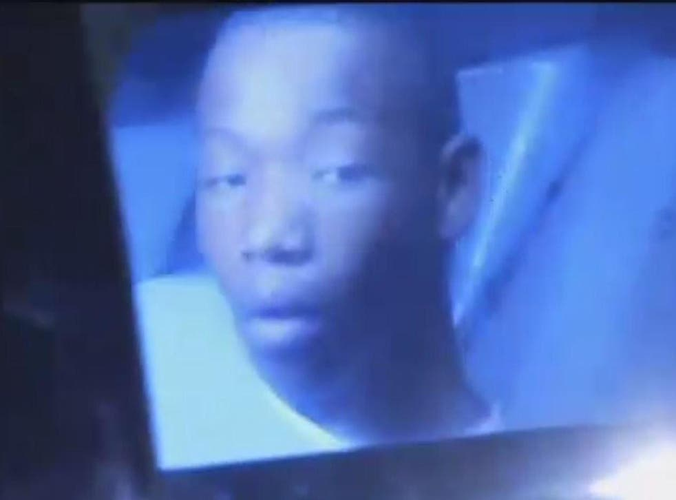Deonte Green in the back of a police car after his arrest
