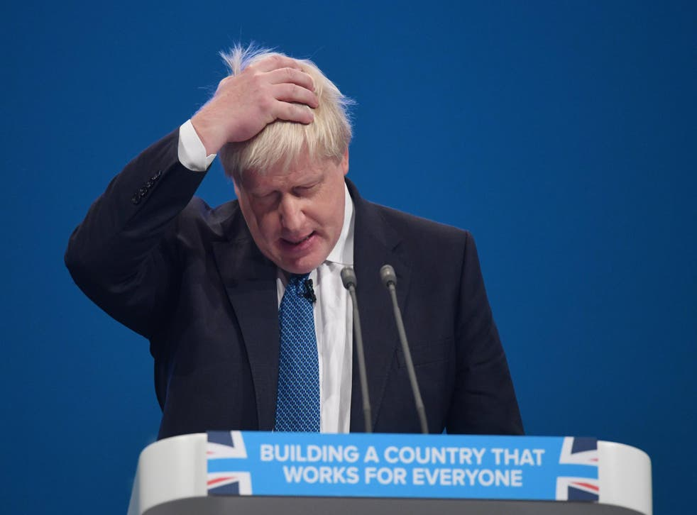 The Foreign Secretary arrived on stage as if to collect a raffle prize