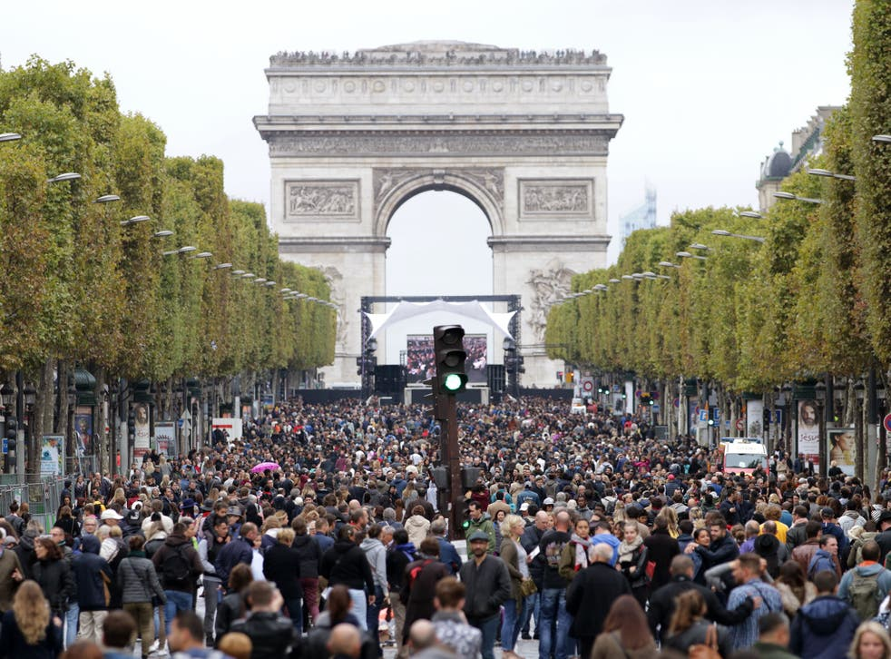 Pedestrians walking along the Champs Elysees during the car free day in Paris