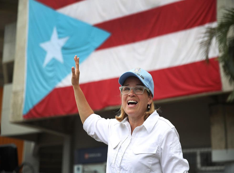 San Juan Mayor Carmen Yulin Cruz speaks to the media as she arrives at the temporary government center setup at the Roberto Clemente stadium in the aftermath of Hurricane Maria