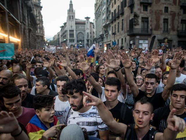 Thousands chant slogans as they gather outside the General Direction of the National Police of Spain building in Barcelona
