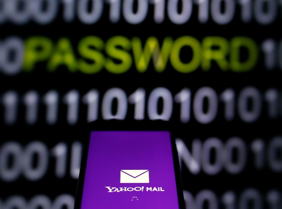 Yahoo Mail logo is displayed on a smartphone's screen in front of a code in this illustration taken in October 6, 2016