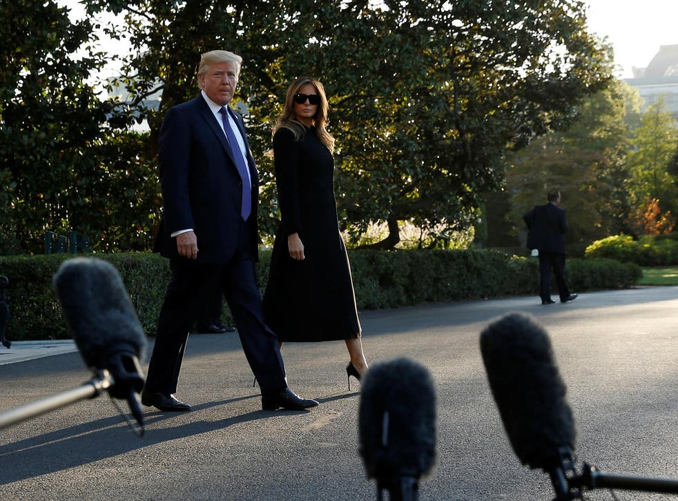US President Donald Trump and First Lady Melania Trump depart for travel to Las Vegas, in the aftermath of the shooting there, from the South Lawn of the White House in Washington