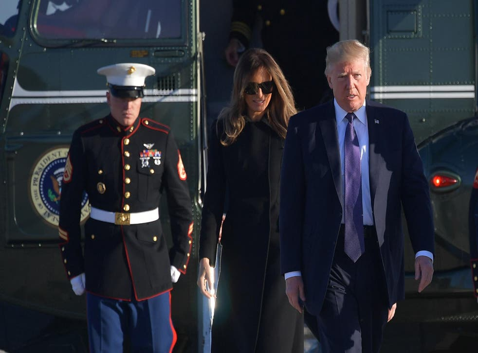 Donald Trump and Melania Trump make their way to board Air Force One before departing for Las Vegas