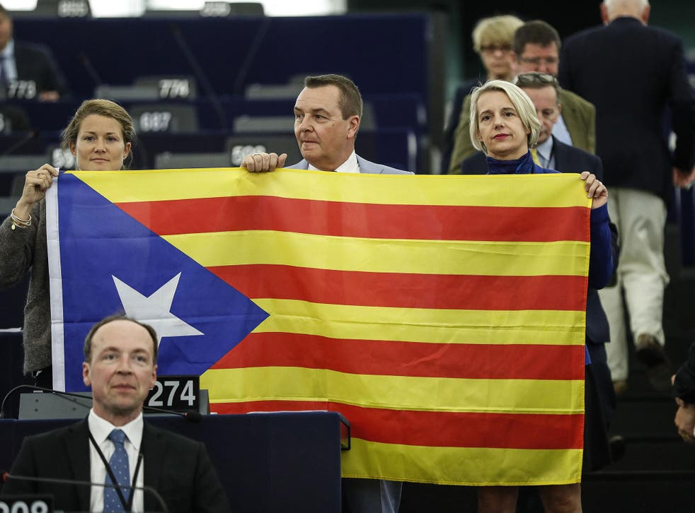 Belgium members of the European Parliament display a Catalan flag in support of the disputed independence movement during a session at the European Parliament on Wednesday