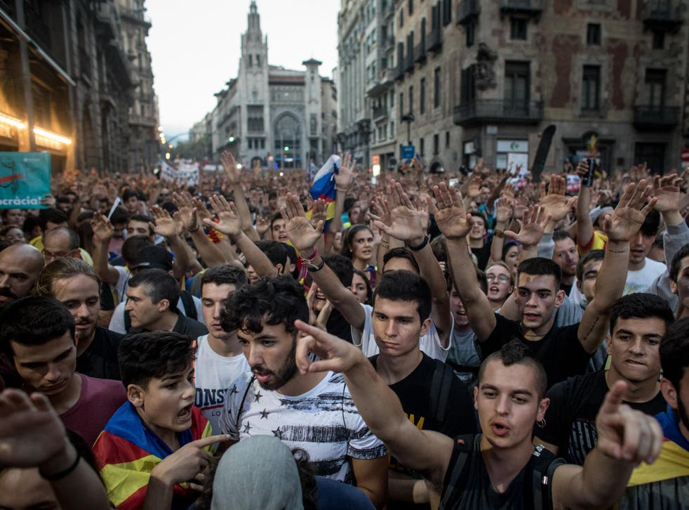 Thousands protested in Barcelona against the violence that marred Sunday's referendum vote