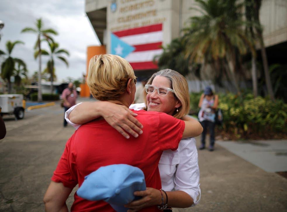 Mayor of San Juan Carmen Yulin Cruz embraces Esperanza Ruiz, a city administrator, outside the government centre at the Roberto Clemente Coliseum after Hurricane Maria in San Juan, Puerto Rico