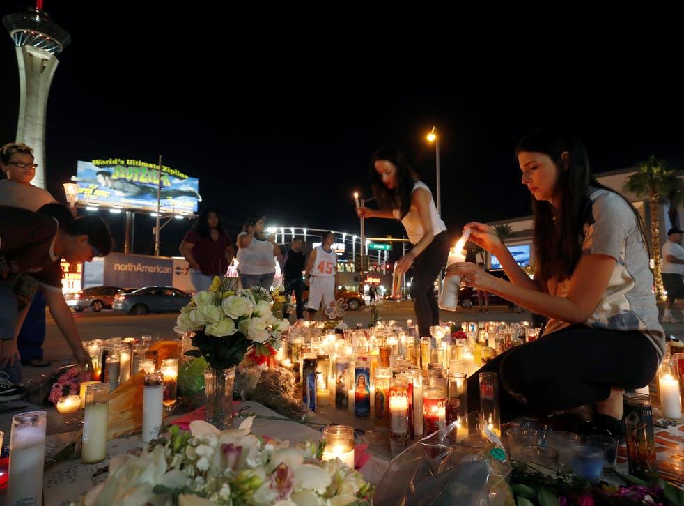 Candles at a makeshift memorial for shooting victims at the Las Vegas Strip