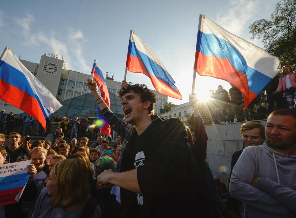 Happy birthday: nationwide demonstrations, including this one in Vladivostok, greeted Vladimir Putin