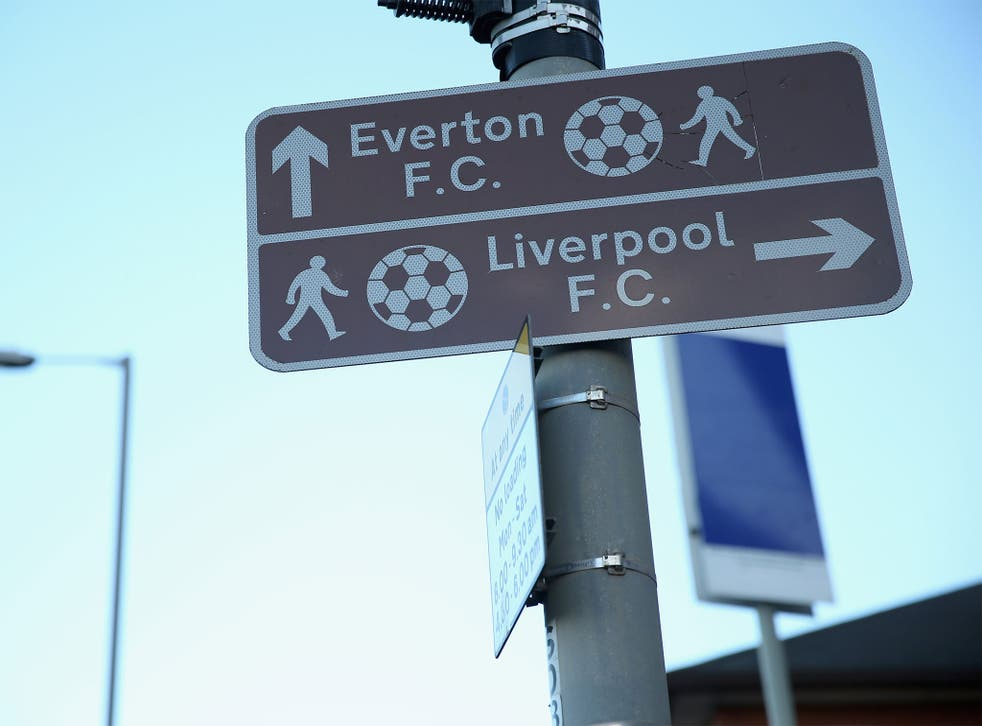 Road signs show geometrically-impossible footballs