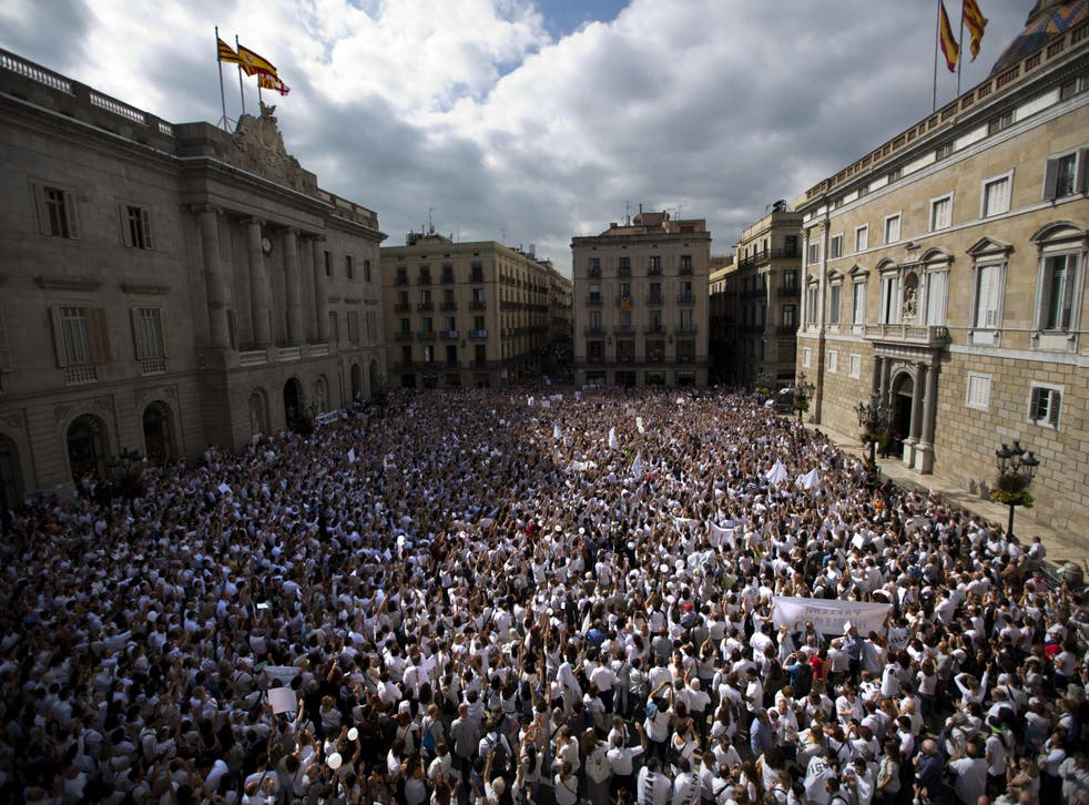 Thousands gathered in Barcelona wearing white and carrying doves as a symbol of their desire for a peaceful solution to the Catalonia crisis