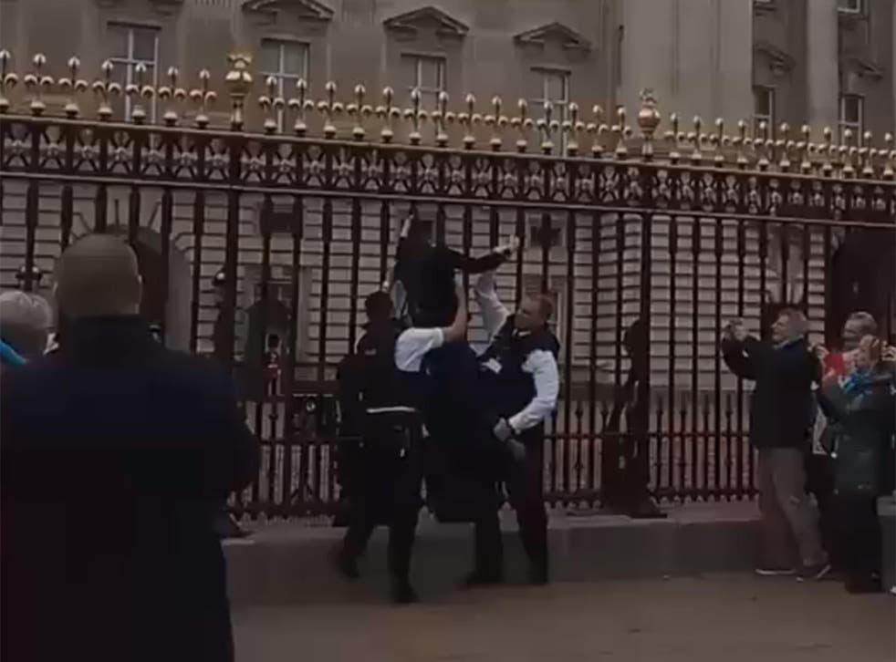The woman was hauled off the gates