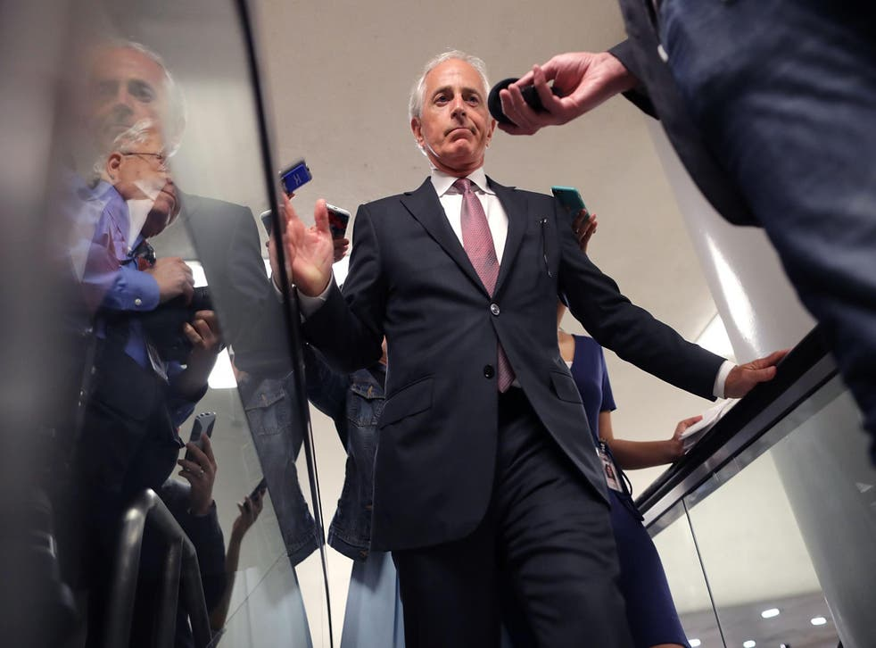 Senate Foreign Relations Committee Chairman Bob Corker talks with reporters