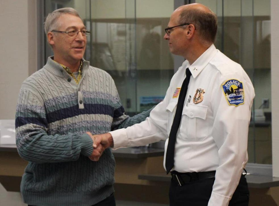 Earl Melchert, left, who helped rescue the 15-year-old kidnapping victim Jasmine Block, with Police Chief Richard Wyffels of Alexandria, Minnesota