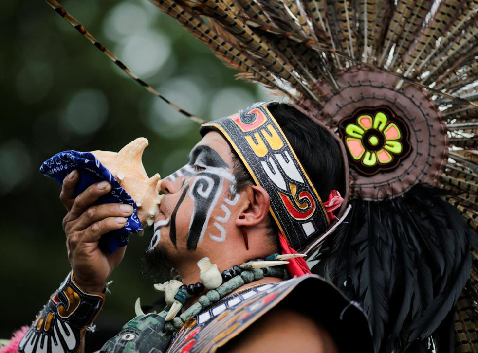 """A reveler performs during a """"pow-wow"""" celebrating the Indigenous Peoples' Day Festival in Randalls Island in New York on 8 October 2017"""
