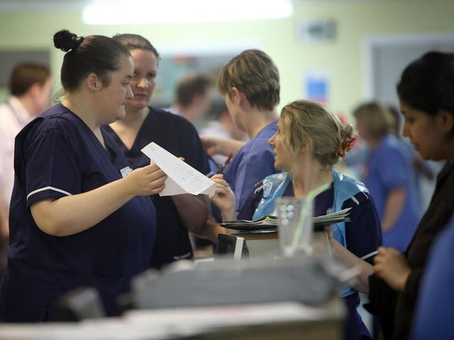 Nurses work during a busy shift in an A&E department
