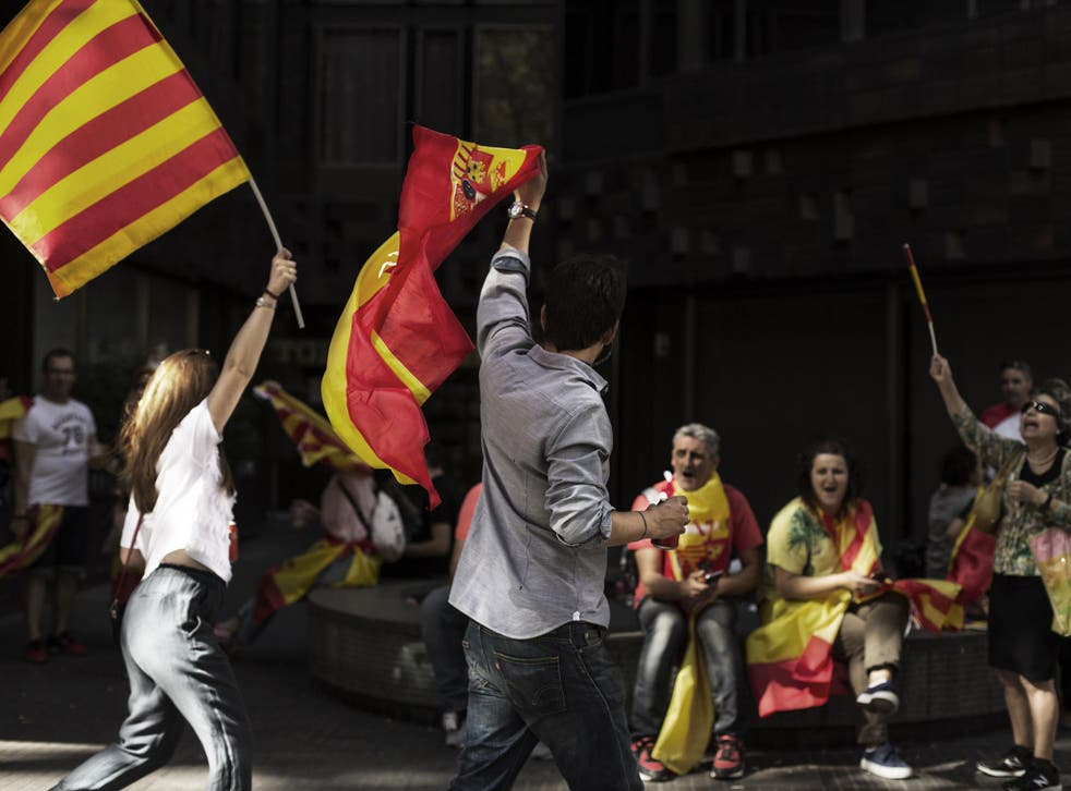 People make their way home following a Pro-Unity rally march through Barcelona