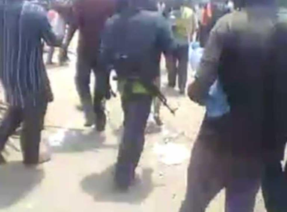 The video shows rebels carrying weapons