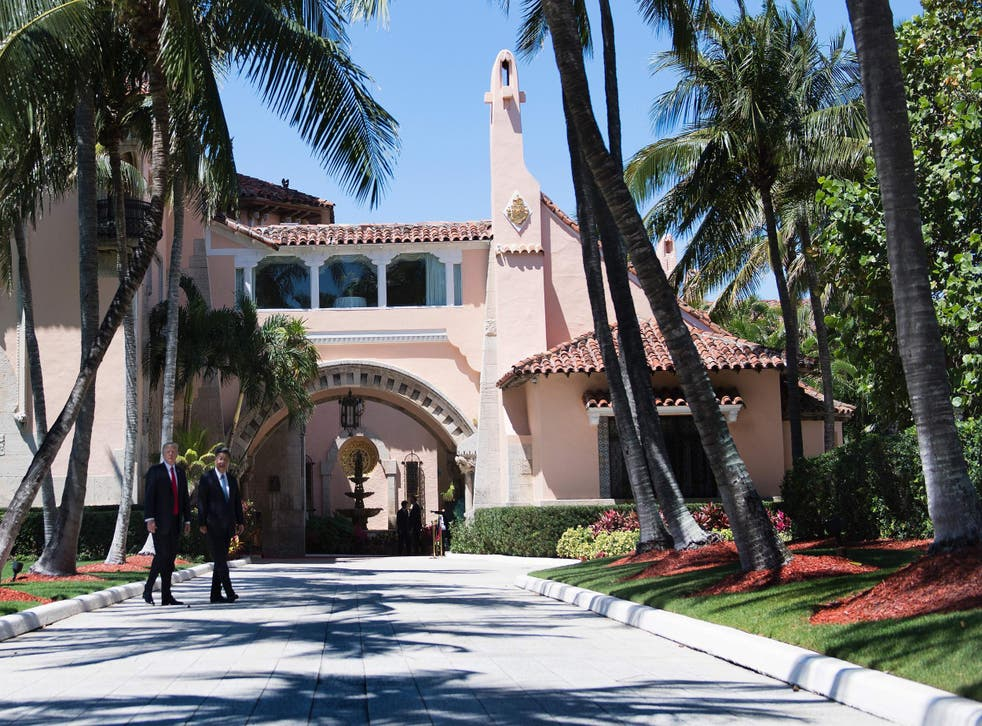 Donald Trump and Chinese President Xi Jinping walk together at the Mar-a-Lago estate in West Palm Beach, Florida