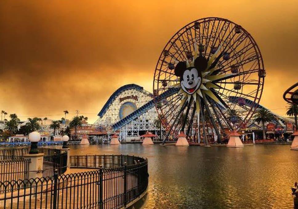 Apocalyptic orange sky above Disneyland California as rides