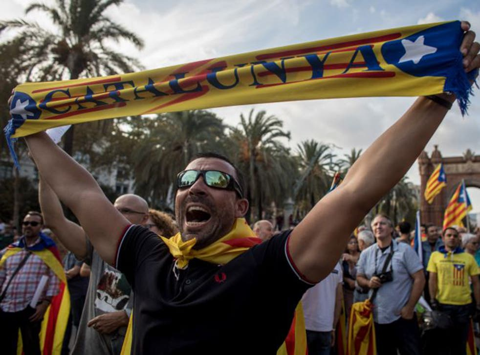 Pro-independence supporters outside the parliament of Catalunya in Barcelona yesterday