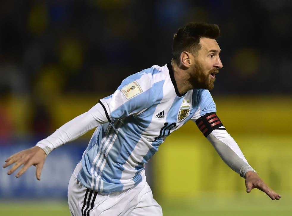 Argentina's Lionel Messi celebrates after scoring his third goal against Ecuador
