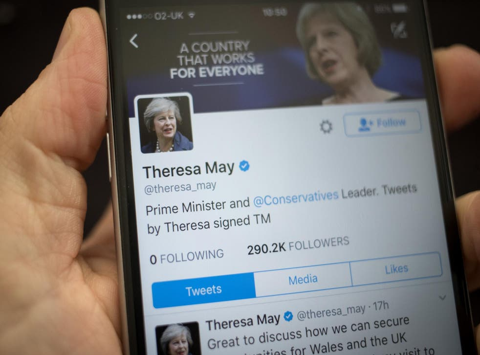 This photo illustration shows the Twitter page for Prime Minister Theresa May on an iPhone on April 26, 2017 in Bristol, England