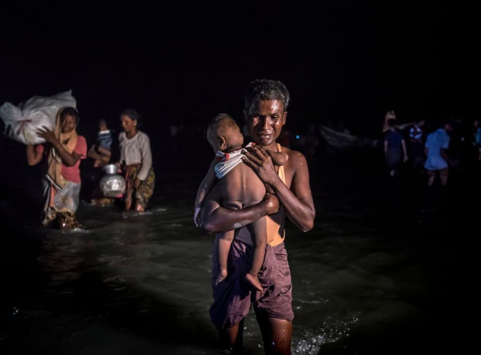 Rohingya refugees arriving in Bangladesh after crossing the Naf River this month