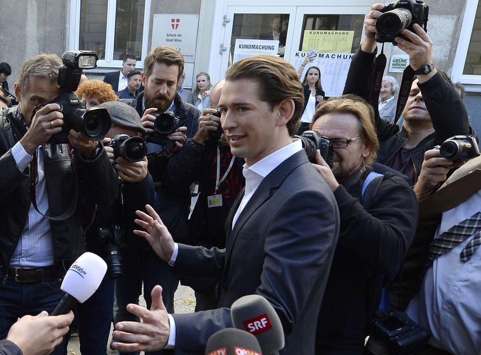 Austria's Foreign Minister and leader of Austria's centre-right People's Party (OeVP) Sebastian Kurz talks with journalists in front of a polling station during general elections in Vienna