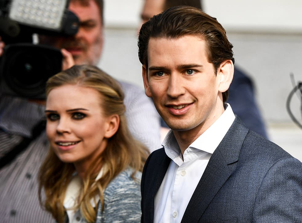 Austrian Peoples Party leader Sebastian Kurz and his girlfriend Susanne Thier cast their votes at a polling station in Vienna