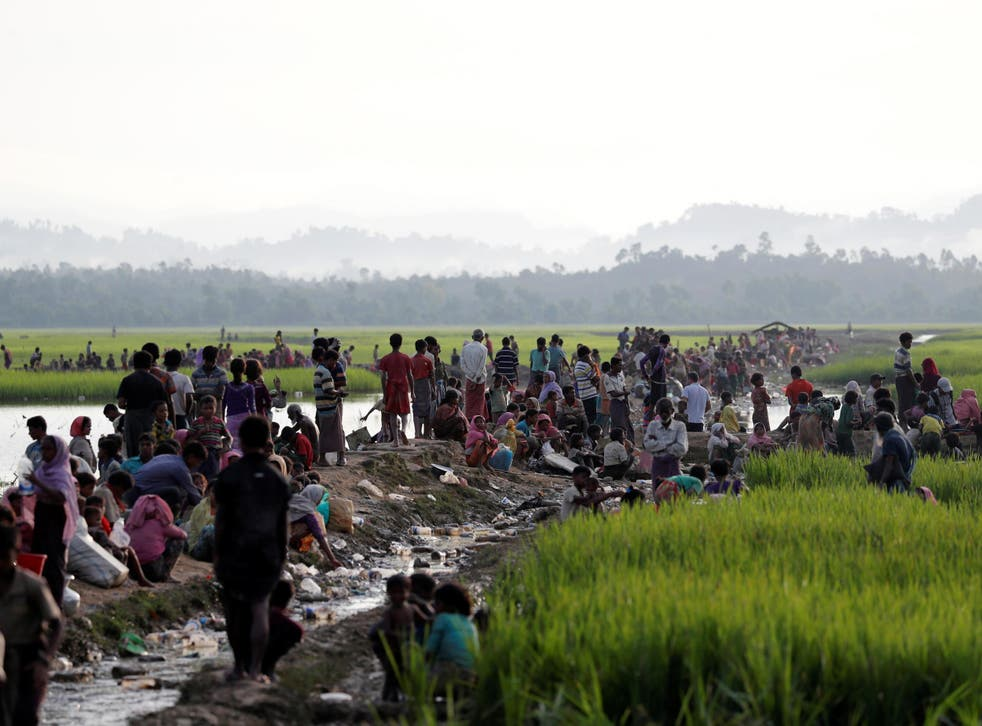 Rohingya refugees crossing the border into Bangladesh to escape persecution at home