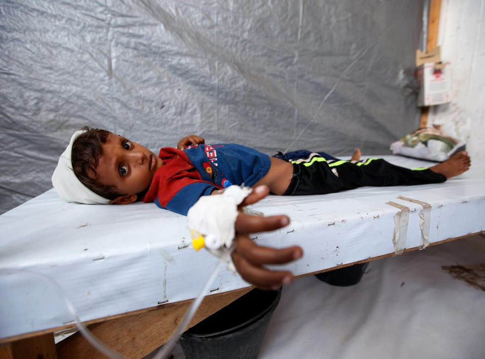 Seven-year-old Siddique Nuruddin Ali is treated for cholera in the Red Sea port city of Al Hudaydah, Yemen, earlier this month
