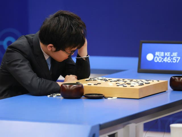 Chinese Go player Ke Jie reacts during his second match against Google's artificial intelligence program AlphaGo at the Future of Go Summit in Wuzhen, Zhejiang province, China May 25, 2017