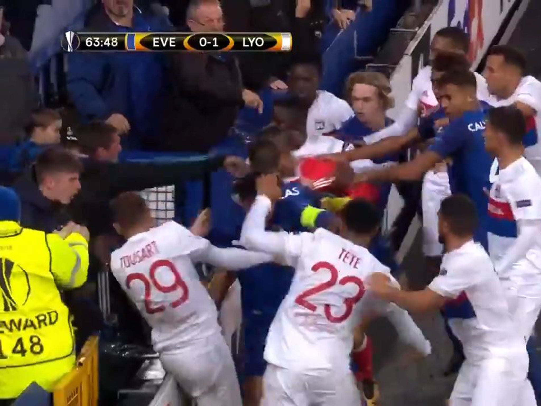 Everton fan appears to throw punch at Lyon player while holding child