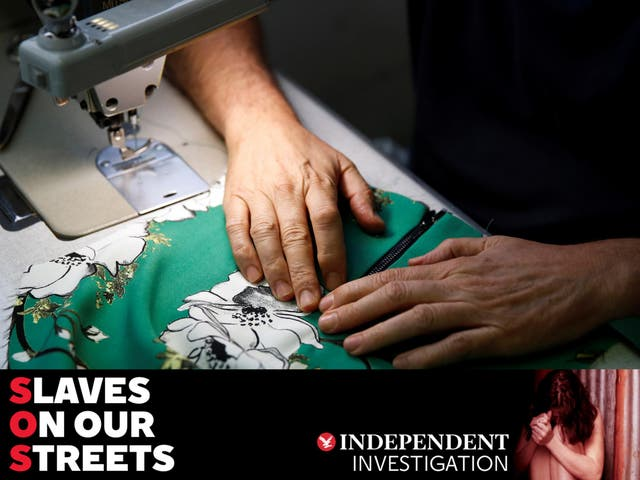 A worker sews clothes in a textile factory