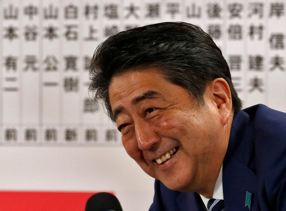 Japan's Prime Minister Shinzo Abe, leader of the Liberal Democratic Party (LDP), smiles during a news conference after winning his country's lower house election