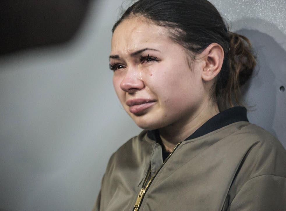 Alyona Zaitseva, 20, breaks down during a court hearing