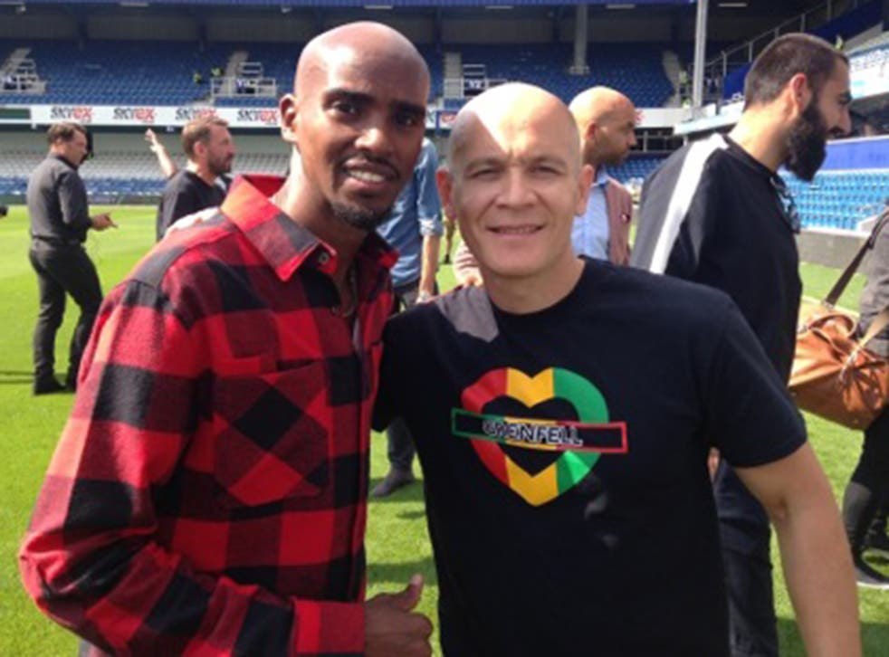 Firefighter David Badillio with Mo Farah at the Game for Grenfell