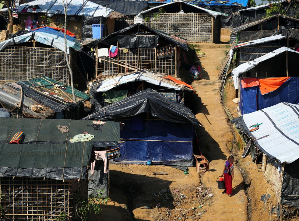 In Kutupalong Camp, Bangladesh, two whole families live together under a single piece of tarpaulin