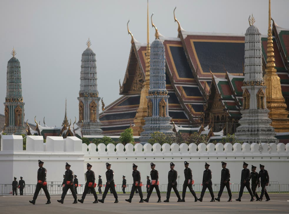 Police patrol outside the Grand Palace in Bangkok where the late king's body is enshrined