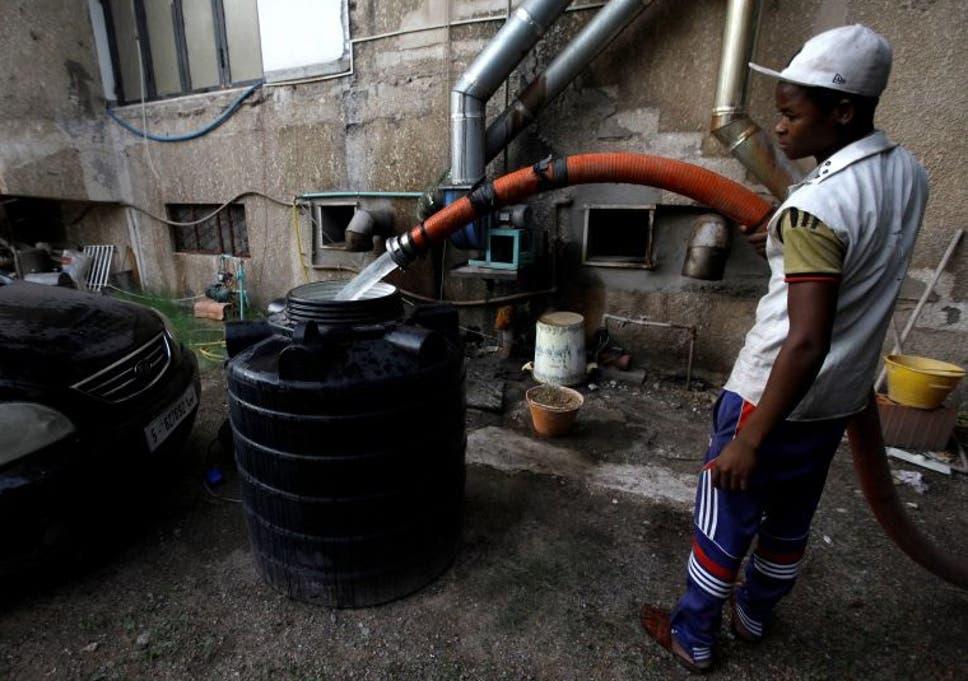 Libya: Residents in Tripoli drill through pavements in desperate bid