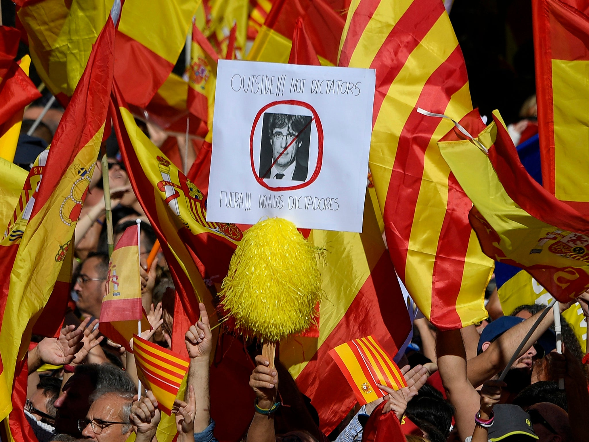Tens of thousands of people take to streets of Barcelona to show loyalty to Spain