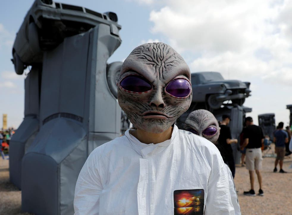 Meagan Shrewsbury and Kim Galyen dress as aliens during the solar eclipse