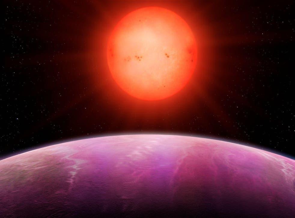 An artist's impression of a planet orbiting a red dwarf star