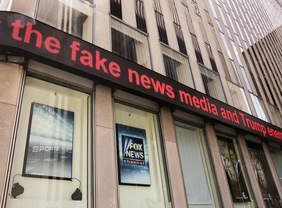 News headlines scroll above the Fox News studios in the News Corporation headquarters building in New York