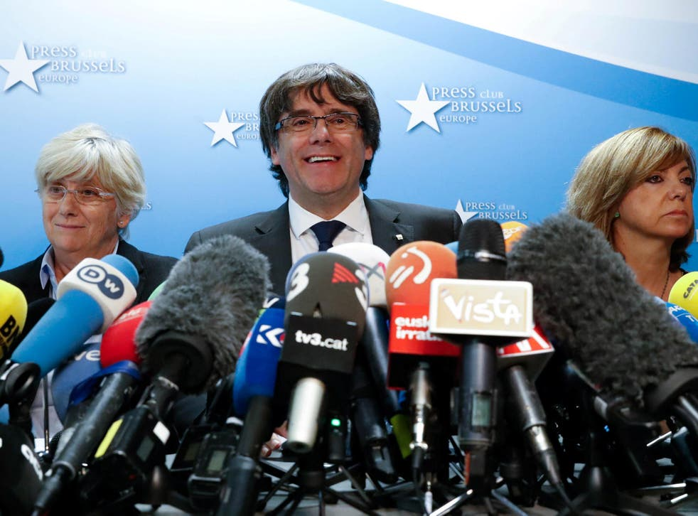 Sacked Catalan leader Carles Puigdemont and former member of the Government of Catalonia Clara Ponsati attend a news conference at the Press Club Brussels Europe in Brussels, Belgium