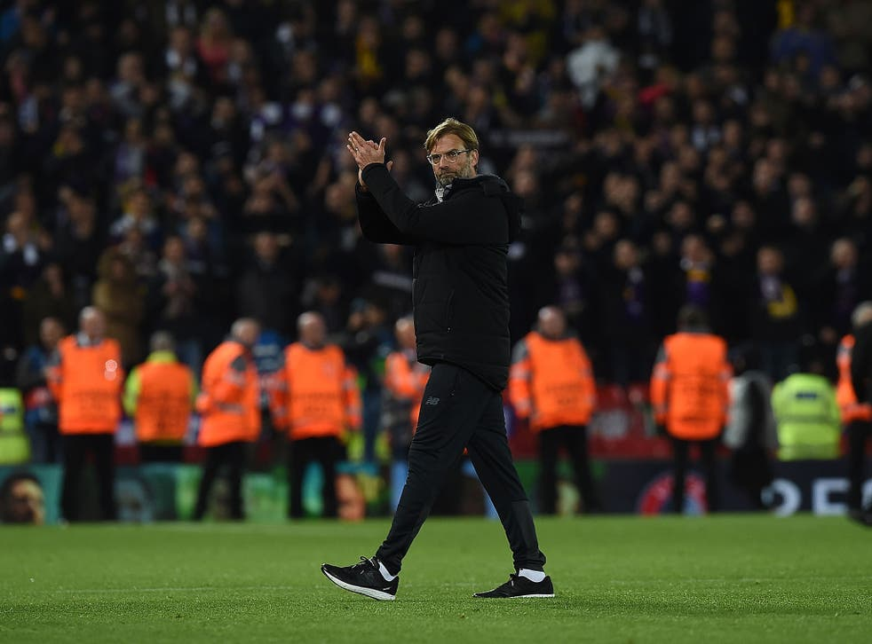 Jurgen Klopp acknowledges the Anfield crowd after Liverpool's victory