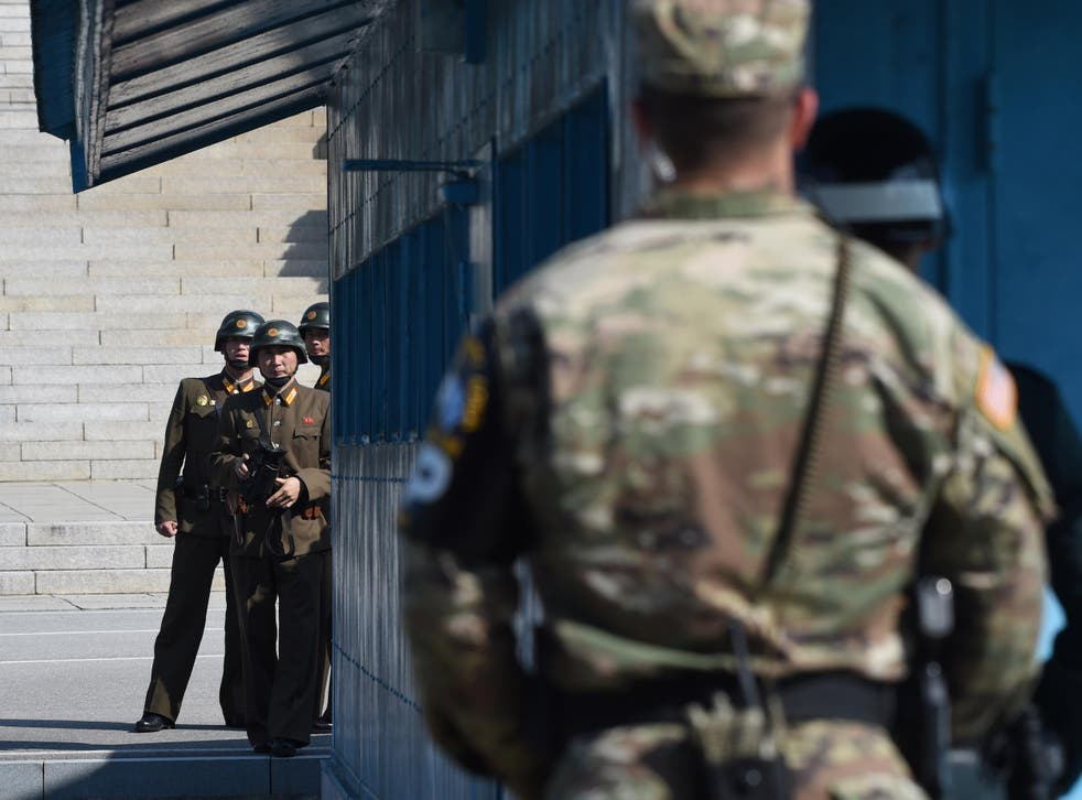 North Korean soldiers look at the South side while US Secretary of Defence Jim Mattis and South Korean Defence Minister Song Young-Moo visit at the truce village of Panmunjom in the Demilitarized Zone on the border between North and South Korea on 27 October 2017
