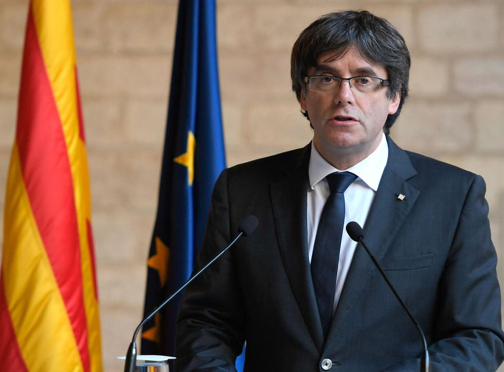 Carles Puigdemont handed himself to police in Brussels after an international arrest warrant was issued for him