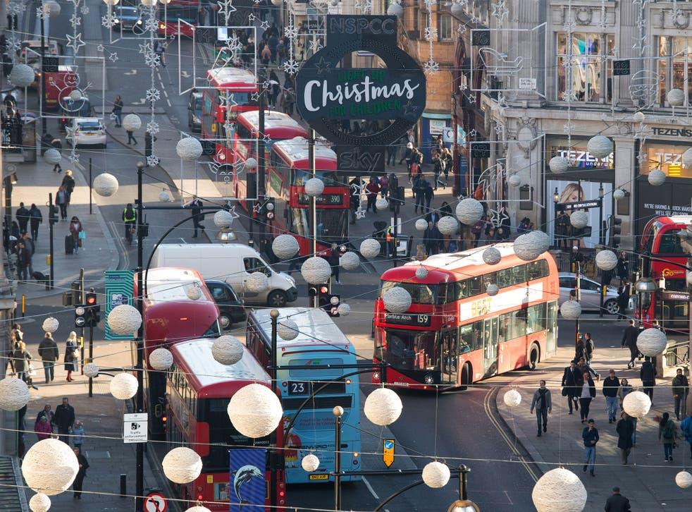 Buses driving around Oxford Street